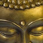 Golden Buddah face. Closeup. Selective focus.